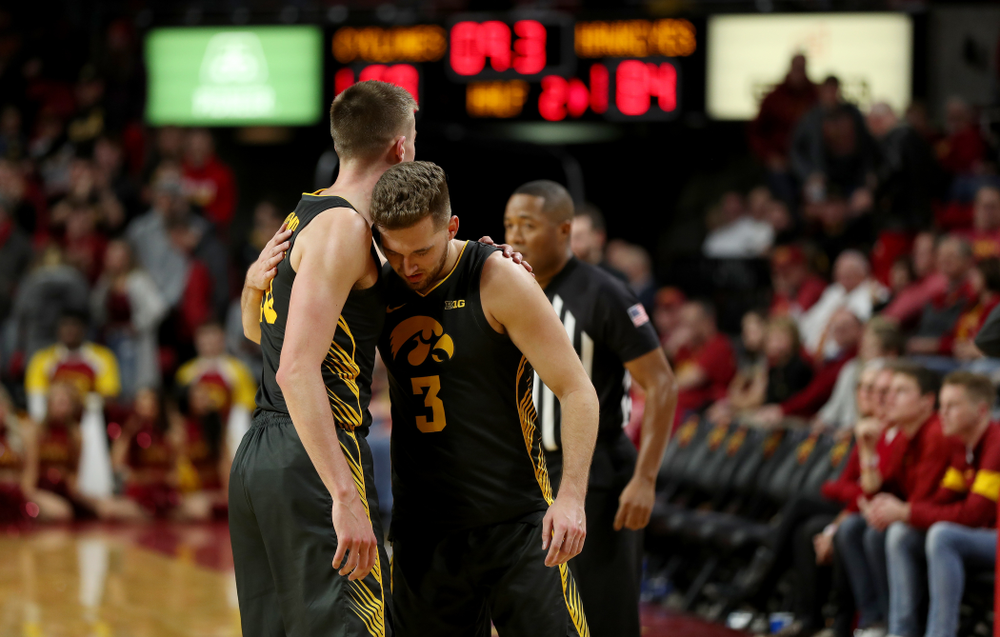 Iowa Hawkeyes guard Jordan Bohannon (3) hugs guard Joe Wieskamp (10) against the Iowa State Cyclones Thursday, December 12, 2019 at Hilton Coliseum in Ames, Iowa(Brian Ray/hawkeyesports.com)