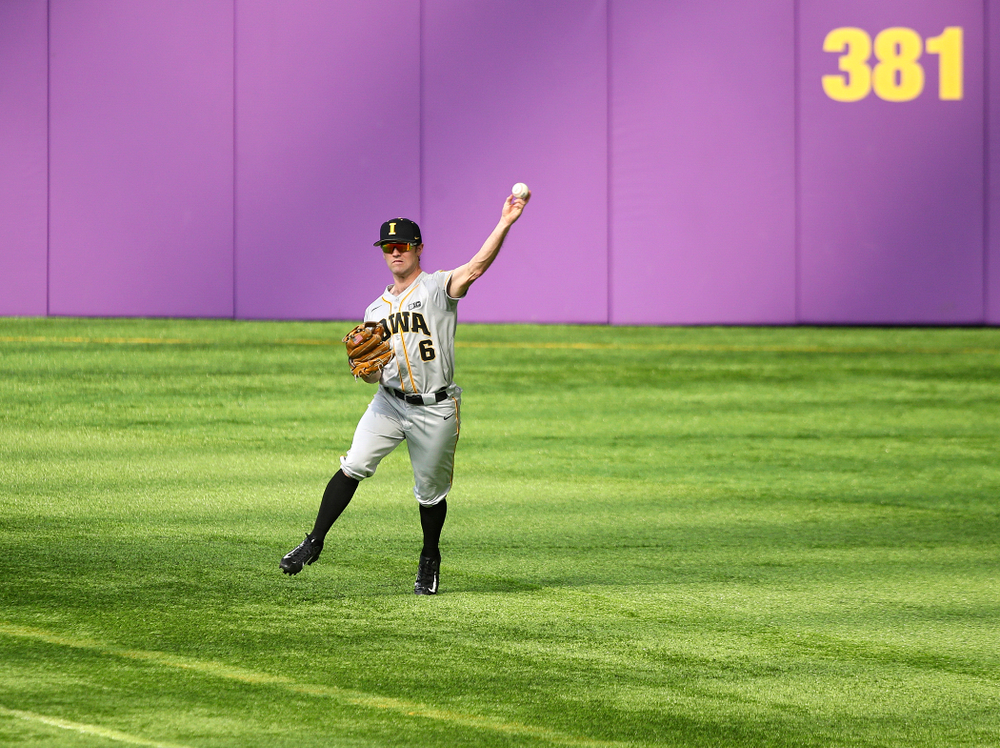 Iowa Hawkeyes outfielder Justin Jenkins (6) throws the ball back in to the infield after catching a fly ball for an out during the third inning of their CambriaCollegeClassic game at U.S. Bank Stadium in Minneapolis, Minn. on Friday, February 28, 2020. (Stephen Mally/hawkeyesports.com)