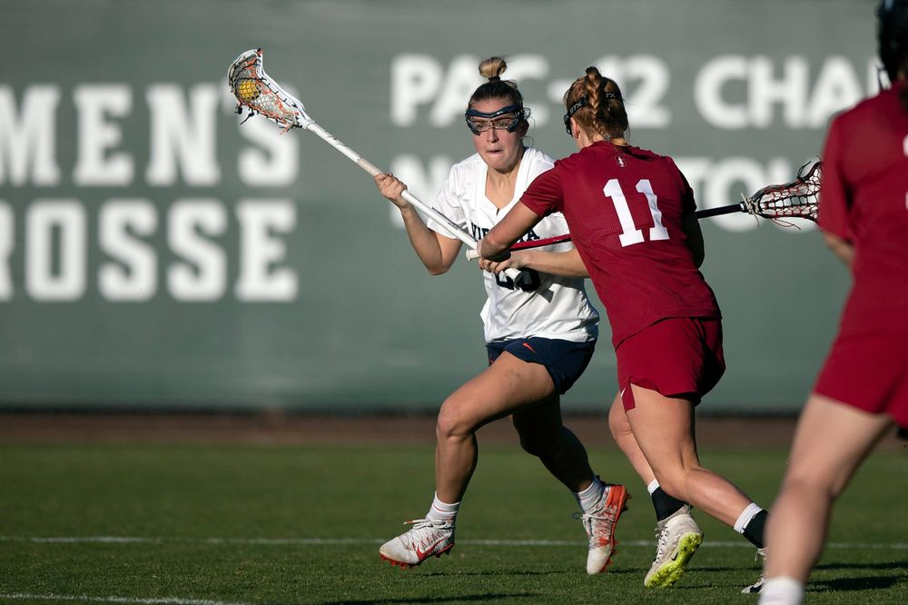 STANFORD, California - FEBRUARY 14: Virginia Cavaliers midfield Nora Bowen (28) is defended by Stanford Cardinal defense Maggie Bellaschi (11) during the second half at Cagan Stadium on February 14, 2020 in Stanford, California. The Virginia Cavaliers defeated the Stanford Cardinal 12-11. (Photo by Jason O. Watson)