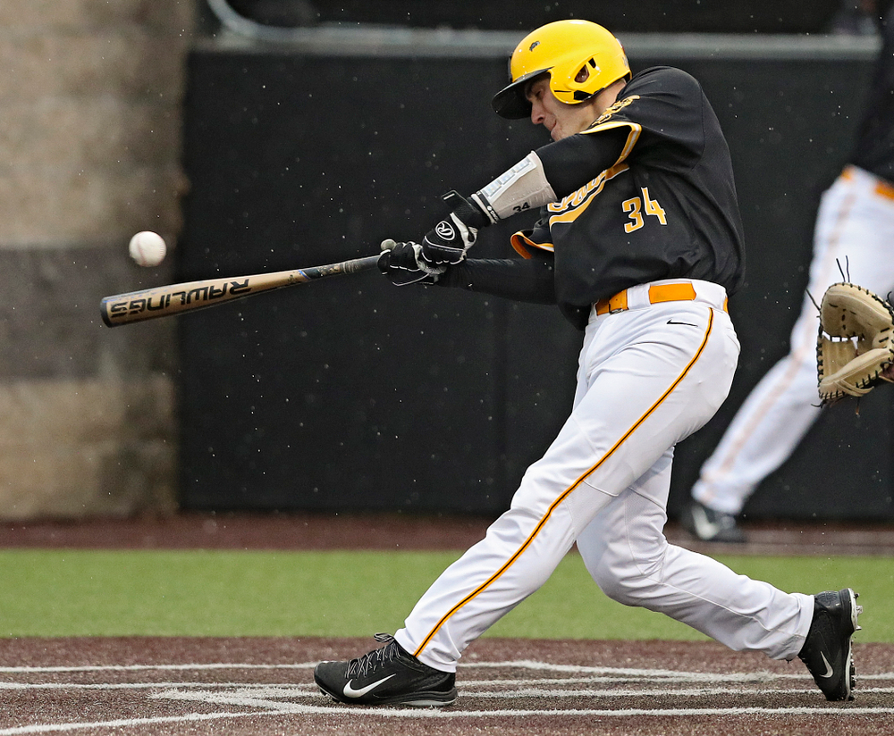 Iowa Hawkeyes catcher Austin Martin (34) drives in a run with a hit during the seventh inning of their game against Illinois State at Duane Banks Field in Iowa City on Wednesday, Apr. 3, 2019. (Stephen Mally/hawkeyesports.com)