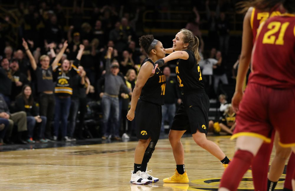 Iowa Hawkeyes guard Tania Davis (11) celebrates with guard Kathleen Doyle (22) after making the game winning three point basket against the Iowa State Cyclones in the Iowa Corn Cy-Hawk Series Wednesday, December 5, 2018 at Carver-Hawkeye Arena. (Brian Ray/hawkeyesports.com)