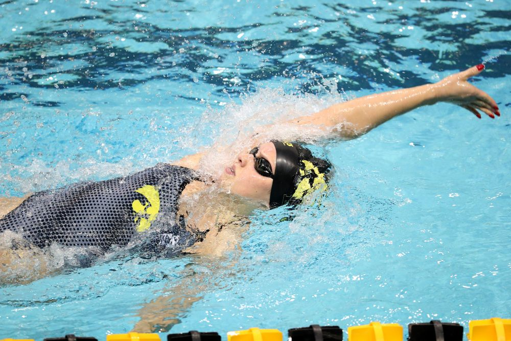 IowaÕs Julia Koluch swims the backstroke leg of the 200 Medley Relay against Notre Dame and Illinois Saturday, January 11, 2020 at the Campus Recreation and Wellness Center.  (Brian Ray/hawkeyesports.com)