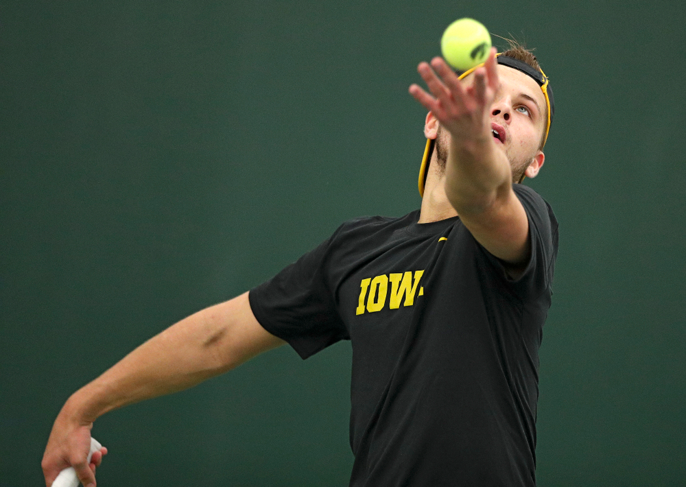 Iowa's Will Davies serves during his match against Marquette at the Hawkeye Tennis and Recreation Complex in Iowa City on Saturday, January 25, 2020. (Stephen Mally/hawkeyesports.com)