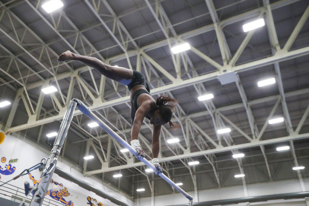 Jerquavia Henderson performs on the uneven bars during the Iowa women's gymnastics Black and Gold Intraquad Meet on Saturday, December 7, 2019 at the UI Field House. (Lily Smith/hawkeyesports.com)