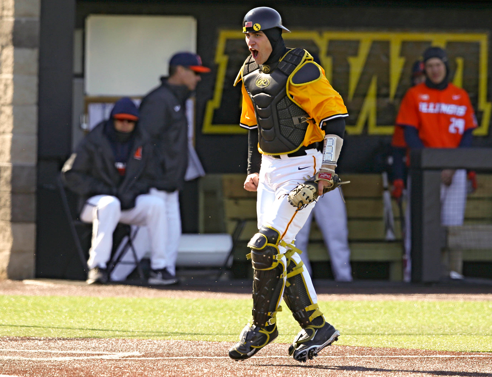 Iowa Hawkeyes catcher Austin Martin (34) is pumped up after completing an inning ending double play during the eighth inning against Illinois at Duane Banks Field in Iowa City on Sunday, Mar. 31, 2019. (Stephen Mally/hawkeyesports.com)