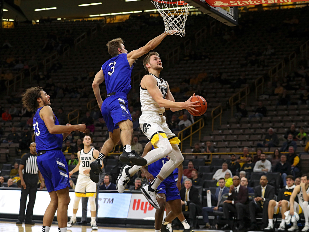 Iowa Hawkeyes forward Riley Till (20) puts up a shot during the second half of their exhibition game against Lindsey Wilson College at Carver-Hawkeye Arena in Iowa City on Monday, Nov 4, 2019. (Stephen Mally/hawkeyesports.com)