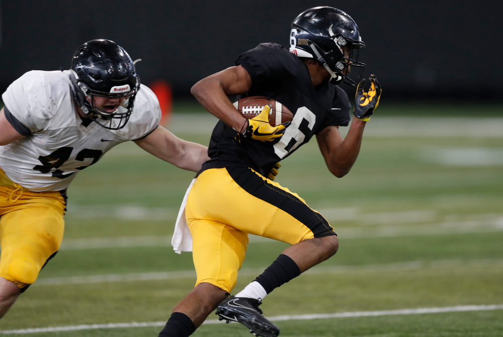 Iowa Hawkeyes wide receiver Ihmir Smith-Marsette (6) and linebacker Dillon Doyle during spring practice  Thursday, March 29, 2018 at the Hansen Football Performance Center. (Brian Ray/hawkeyesports.com)