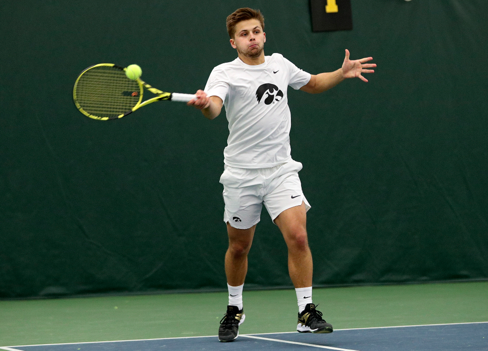 Iowa's during his doubles match at the Hawkeye Tennis and Recreation Complex in Iowa City on Sunday, February 16, 2020. (Stephen Mally/hawkeyesports.com)