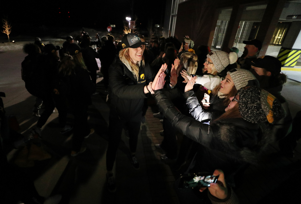 Iowa Hawkeyes forward Hannah Stewart (21) celebrates with fans as they arrive back in Coralville after defeating the Maryland Terrapins in the Big Ten Championship Game Sunday, March 10, 2019 in Indianapolis, Ind. (Brian Ray/hawkeyesports.com)