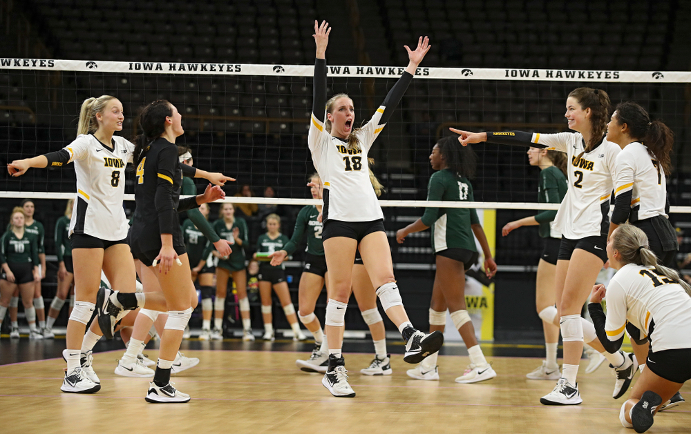 Iowa's Kyndra Hansen (8), Halle Johnston (4), Hannah Clayton (18), Courtney Buzzerio (2), Maddie Slagle (15), and Brie Orr (7) celebrate a score during the fourth set of their volleyball match at Carver-Hawkeye Arena in Iowa City on Sunday, Oct 13, 2019. (Stephen Mally/hawkeyesports.com)