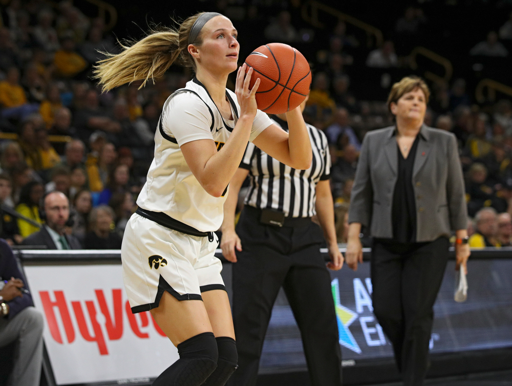 Iowa Hawkeyes guard Makenzie Meyer (3) lines up a 3-pointer during the second quarter of their game at Carver-Hawkeye Arena in Iowa City on Tuesday, December 31, 2019. (Stephen Mally/hawkeyesports.com)