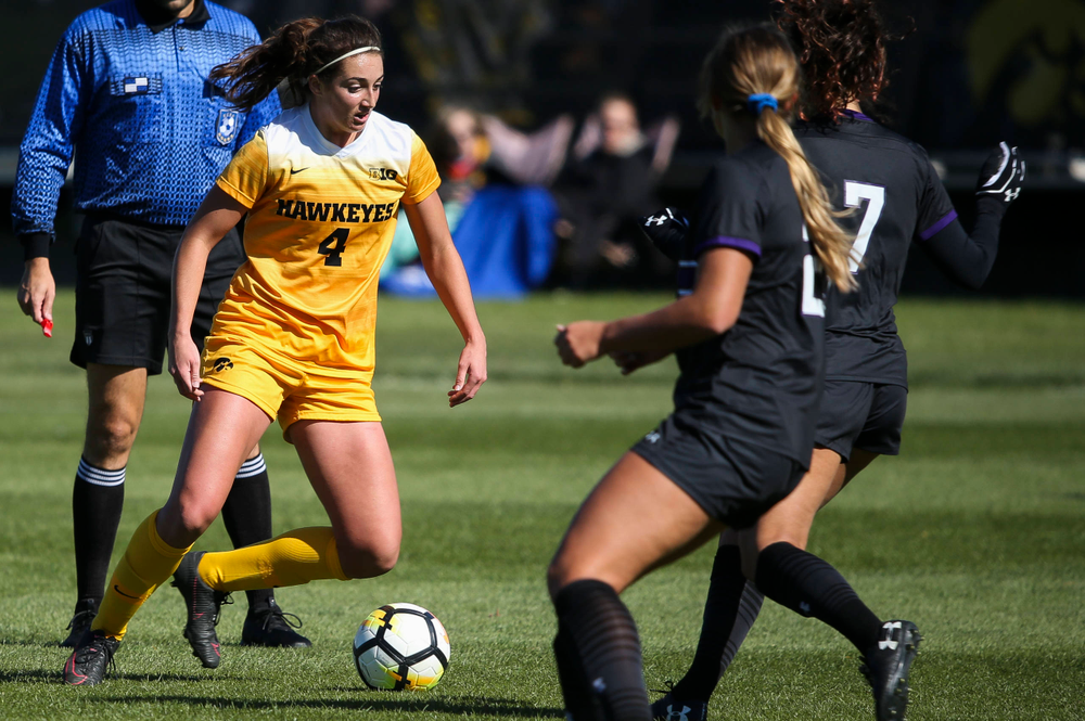 Iowa Hawkeyes forward Kaleigh Haus (4) dribbles the ball during a game against Northwestern at the Iowa Soccer Complex on October 21, 2018. (Tork Mason/hawkeyesports.com)