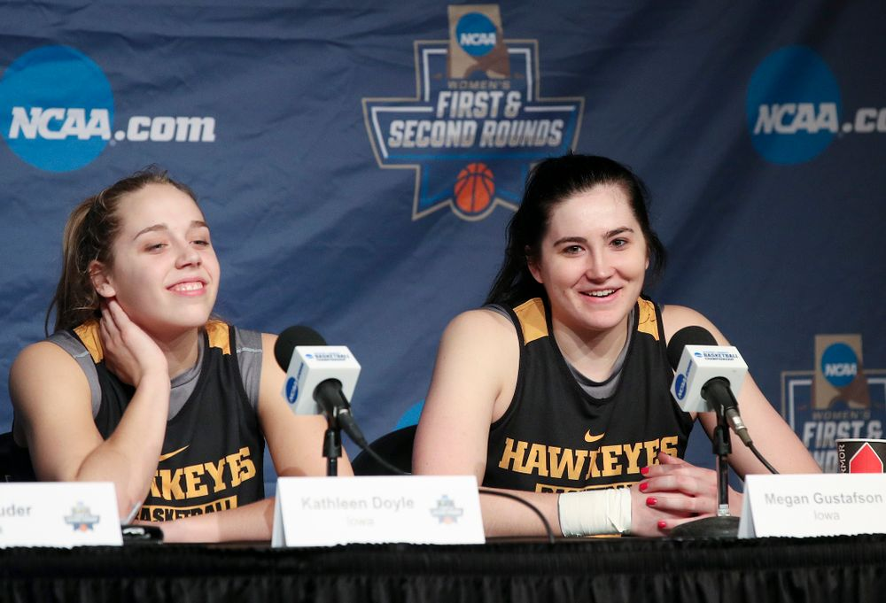 Iowa Hawkeyes guard Kathleen Doyle (22) and forward Megan Gustafson (10) smile during media availability before their next game in the 2019 NCAA Women's Basketball Tournament at Carver Hawkeye Arena in Iowa City on Saturday, Mar. 23, 2019. (Stephen Mally for hawkeyesports.com)