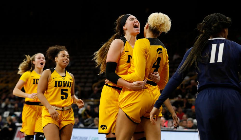 Iowa Hawkeyes forward Megan Gustafson (10) and forward Chase Coley (4)