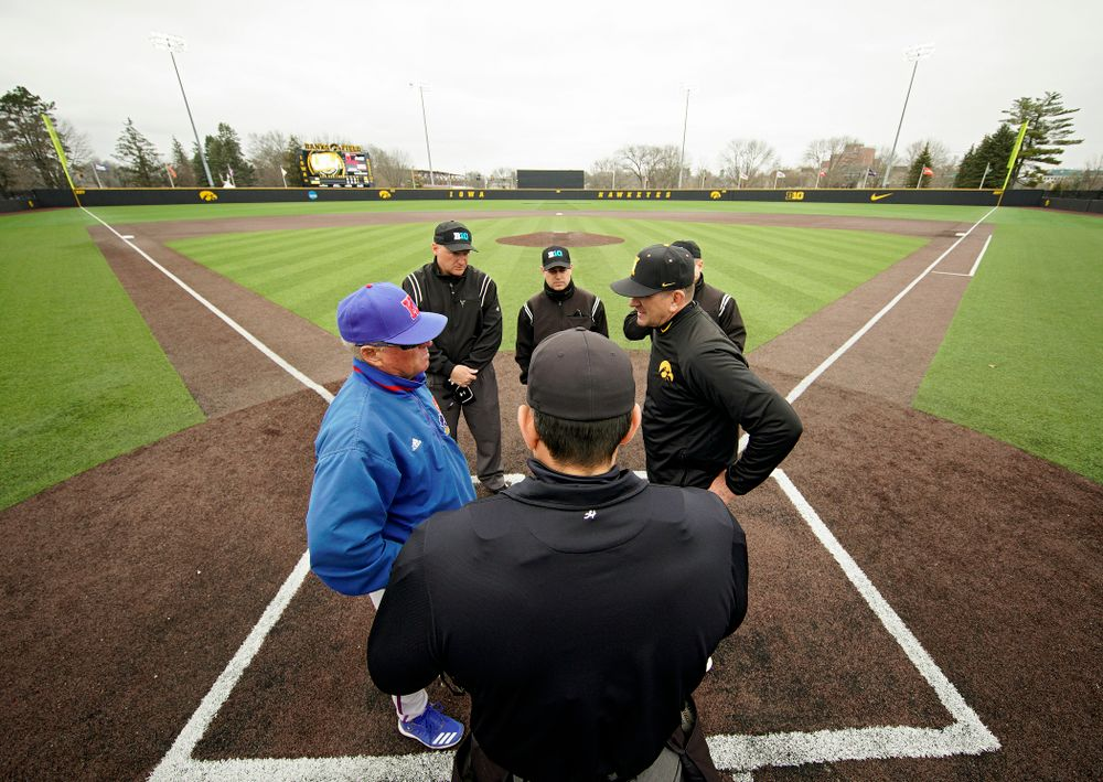 Iowa head coach Rick Heller meets at home plate before the college baseball game at Duane Banks Field in Iowa City on Wednesday, March 11, 2020. (Stephen Mally/hawkeyesports.com)