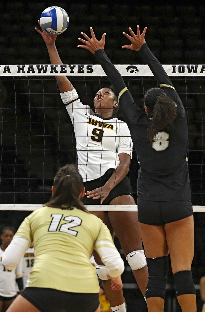 Iowa's Amiya Jones (9) tips the ball over the net during the third set of their Big Ten/Pac-12 Challenge match against Colorado at Carver-Hawkeye Arena in Iowa City on Friday, Sep 6, 2019. (Stephen Mally/hawkeyesports.com)