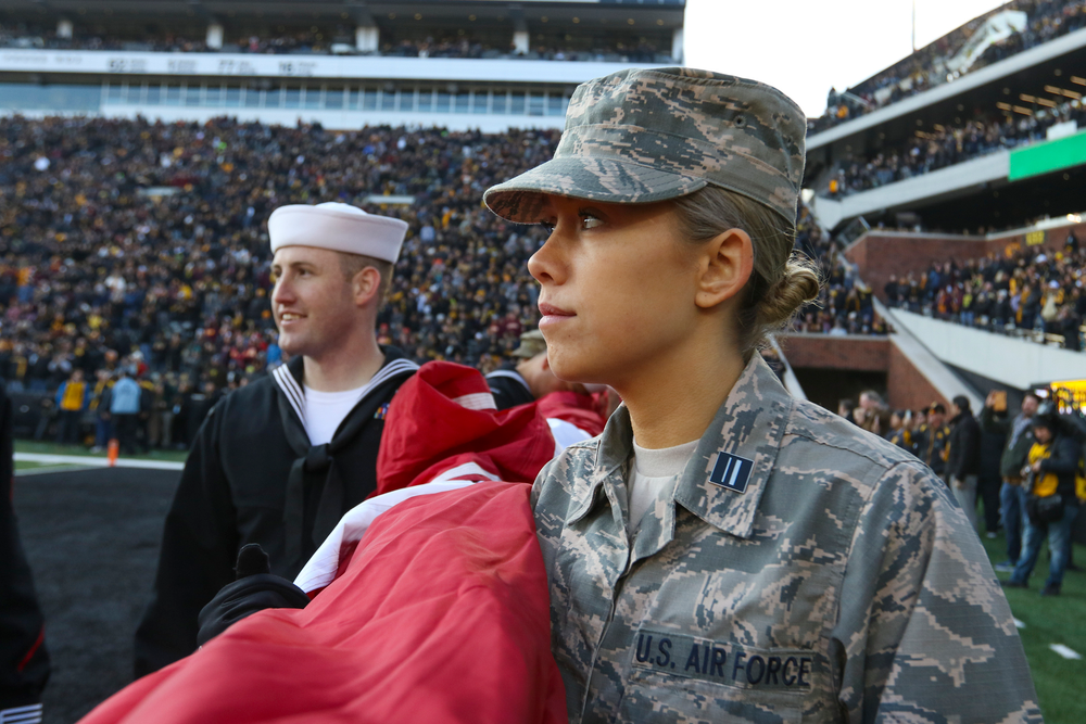 A member of the U.S. Air Force holds an American flag during Iowa football vs Minnesota on Saturday, November 16, 2019 at Kinnick Stadium. (Lily Smith/hawkeyesports.com)