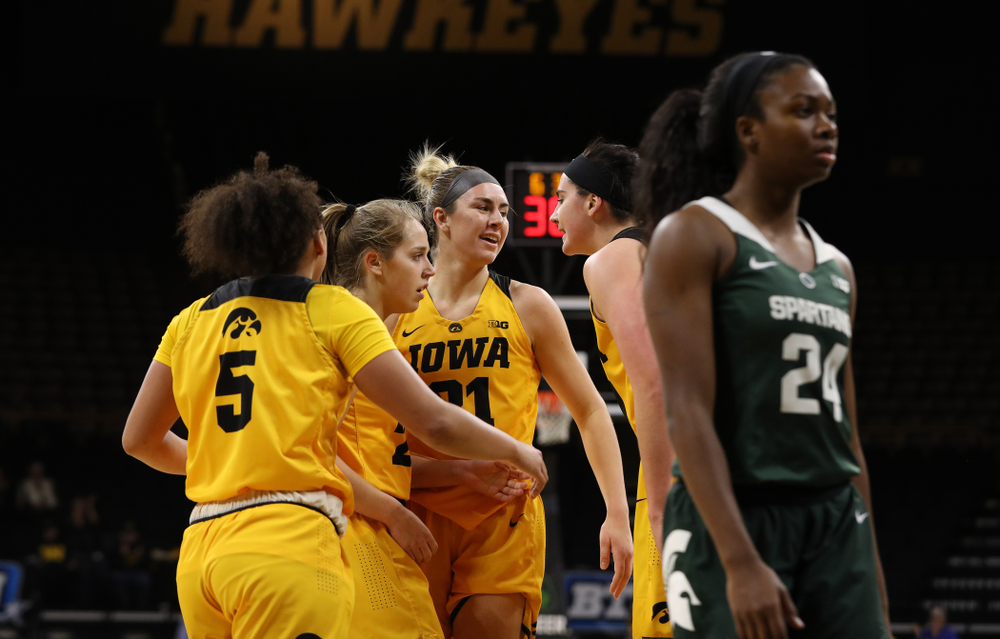 Iowa Hawkeyes guard Alexis Sevillian (5), guard Kathleen Doyle (22), forward Hannah Stewart (21), and forward Megan Gustafson (10) against the Michigan State Spartans Thursday, February 7, 2019 at Carver-Hawkeye Arena. (Brian Ray/hawkeyesports.com)