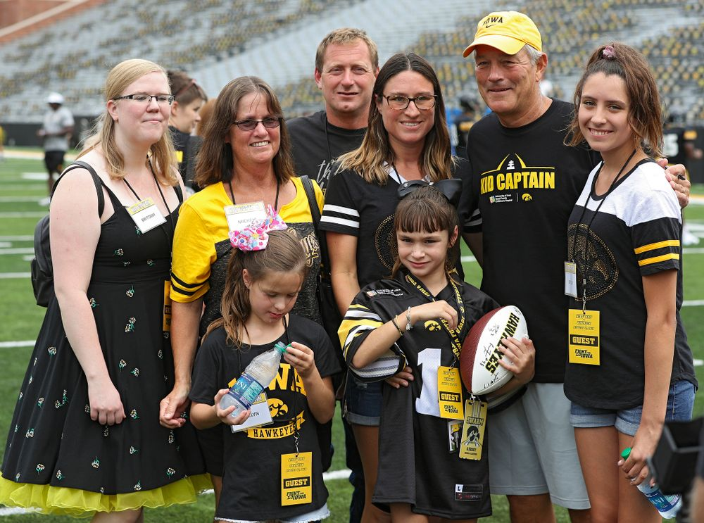 Kid Captain Aubrey Bussan-Kluesner and her family takes a picture with Iowa Hawkeyes head coach Kirk Ferentz during Kids Day at Kinnick Stadium in Iowa City on Saturday, Aug 10, 2019. (Stephen Mally/hawkeyesports.com)