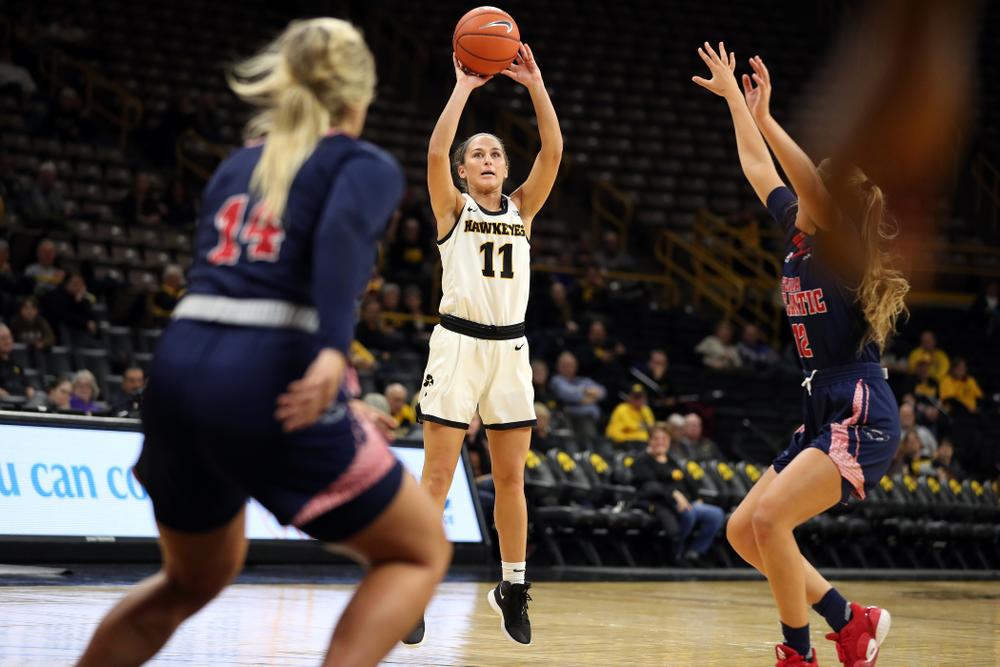 Iowa Hawkeyes guard Megan Meyer (11) knocks down a three point basket against Florida Atlantic University Thursday, November 7, 2019 at Carver-Hawkeye Arena. (Brian Ray/hawkeyesports.com)