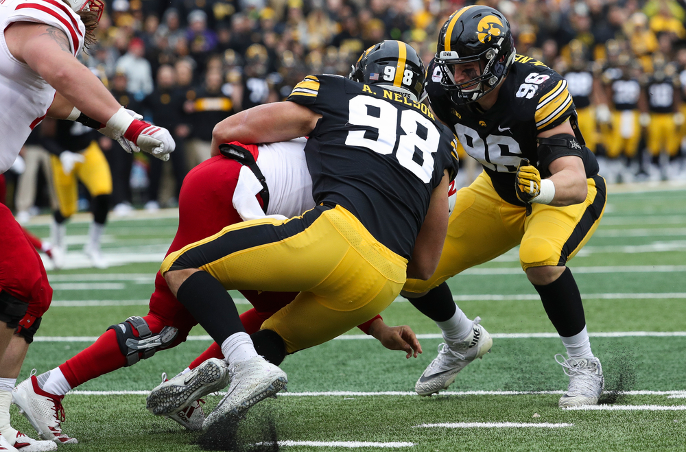 Iowa Hawkeyes defensive end Anthony Nelson (98) and Iowa Hawkeyes defensive lineman Matt Nelson (96) sack the quarterback during a game against Nebraska at Kinnick Stadium on November 23, 2018. (Tork Mason/hawkeyesports.com)
