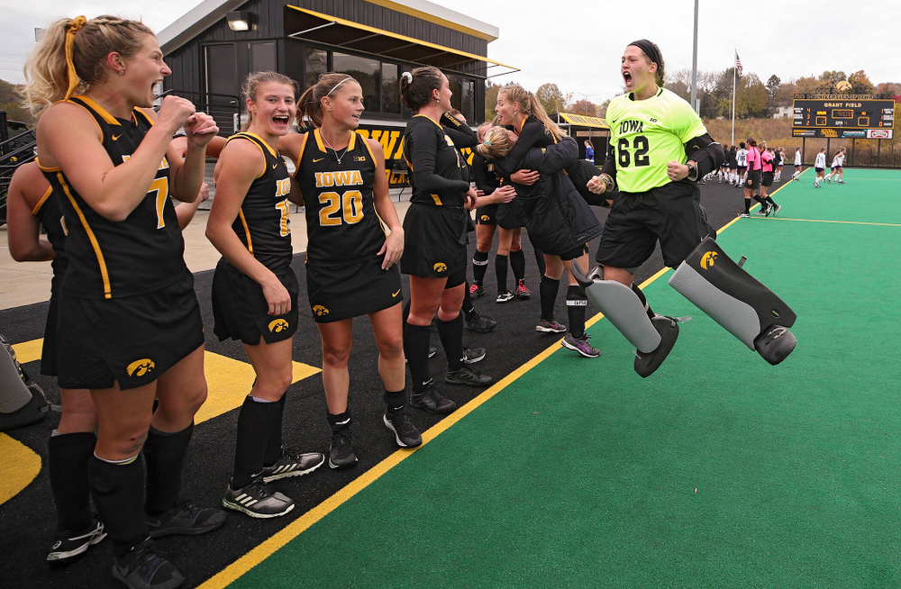 Iowa's Grace McGuire (62) jumps in the air as she celebrates with her teammates after winning their game at Grant Field in Iowa City on Saturday, Oct 26, 2019. (Stephen Mally/hawkeyesports.com)