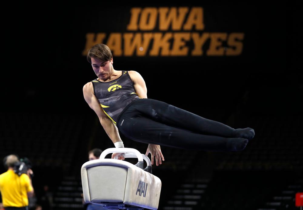 Elijah Parsells competes on the pommel horse against Illinois