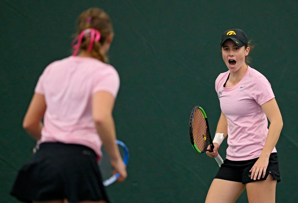 Iowa's Elise van Heuvelen Treadwell (right) and Ashleigh Jacobs celebrates a point during their doubles match against Purdue at the Hawkeye Tennis and Recreation Complex in Iowa City on Friday, Mar. 29, 2019. (Stephen Mally/hawkeyesports.com)