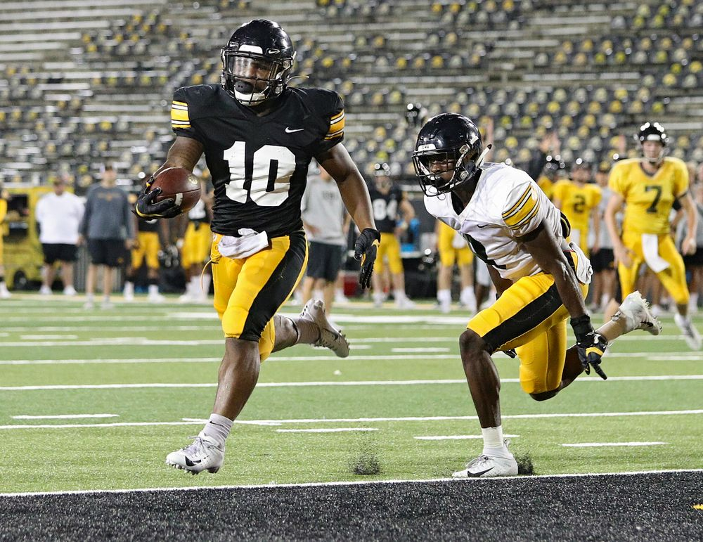 Iowa Hawkeyes running back Mekhi Sargent (10) gets around defensive back Matt Hankins (8) and scores a touchdown during Fall Camp Practice No. 12 at Kinnick Stadium in Iowa City on Thursday, Aug 15, 2019. (Stephen Mally/hawkeyesports.com)