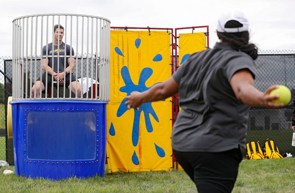 Iowa assistant strength and conditioning coach Cody Roberts sits in the dunk tank during the Student-Athlete Kickoff outside the Karro Athletics Hall of Fame Building in Iowa City on Sunday, Aug 25, 2019. (Stephen Mally/hawkeyesports.com)