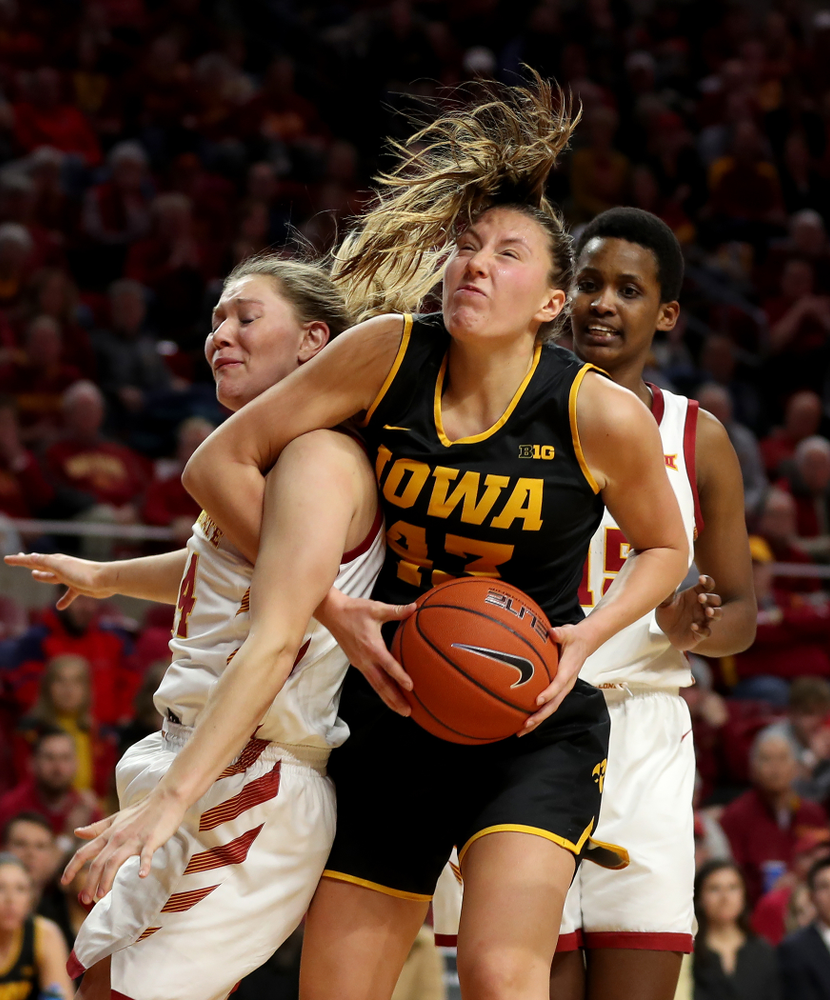 Iowa Hawkeyes forward Amanda Ollinger (43) grabs one of her 20 rebounds against the Iowa State Cyclones Wednesday, December 11, 2019 at Hilton Coliseum in Ames, Iowa(Brian Ray/hawkeyesports.com)