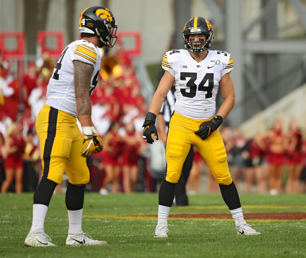 Iowa Hawkeyes defensive end A.J. Epenesa (94) talks with linebacker Kristian Welch (34) before a snap during the first quarter of their Iowa Corn Cy-Hawk Series game at Jack Trice Stadium in Ames on Saturday, Sep 14, 2019. (Stephen Mally/hawkeyesports.com)