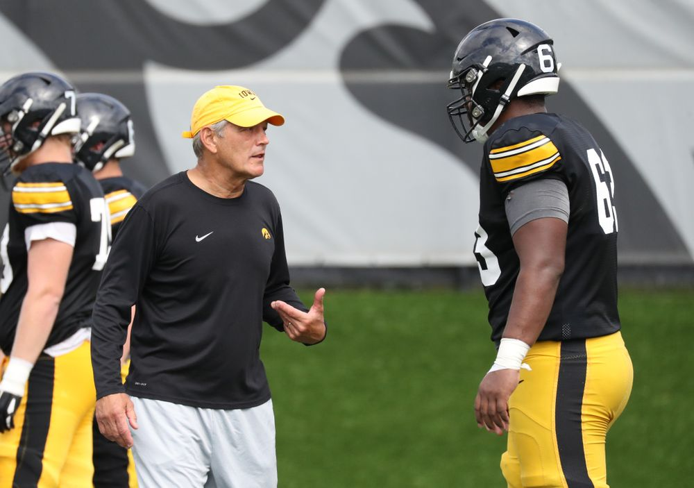 Iowa Hawkeyes head coach Kirk Ferentz with freshman offensive lineman Justin Britt (63)