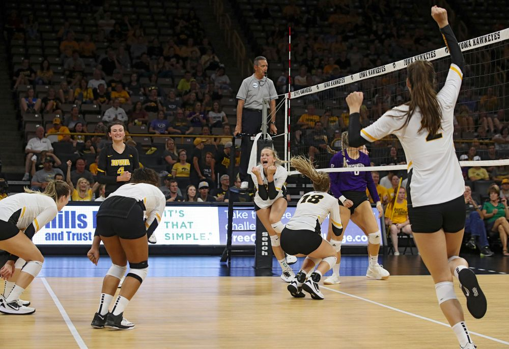 Iowa's Meghan Buzzerio (5), Halle Johnston (4), Brie Orr (7), Kyndra Hansen (8), Hannah Clayton (18) and Courtney Buzzerio (2) celebrate a score during their Big Ten/Pac-12 Challenge match at Carver-Hawkeye Arena in Iowa City on Saturday, Sep 7, 2019. (Stephen Mally/hawkeyesports.com)