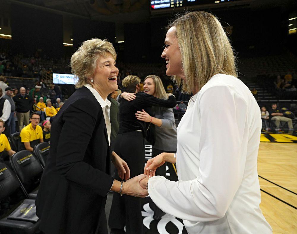 Iowa Hawkeyes head coach Lisa Bluder talks with Drake Bulldogs head coach Jennie Baranczyk before their game at Carver-Hawkeye Arena in Iowa City on Saturday, December 21, 2019. (Stephen Mally/hawkeyesports.com)