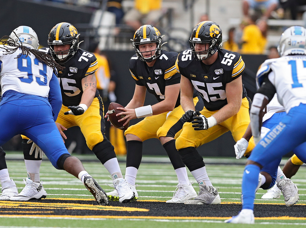 Iowa Hawkeyes quarterback Spencer Petras (7) takes a snap from offensive lineman Jeff Jenkins (75) during fourth quarter of their game at Kinnick Stadium in Iowa City on Saturday, Sep 28, 2019. (Stephen Mally/hawkeyesports.com)
