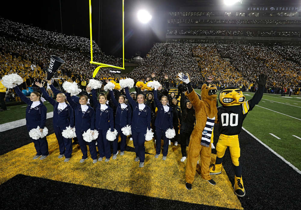The Penn State cheerleaders and the Nittany Lion stand with the Iowa Hawkeyes cheerleaders and Herky as they wave to the University of Iowa Stead Family Children's Hospital between the first and second quarters of their game at Kinnick Stadium in Iowa City on Saturday, Oct 12, 2019. (Stephen Mally/hawkeyesports.com)