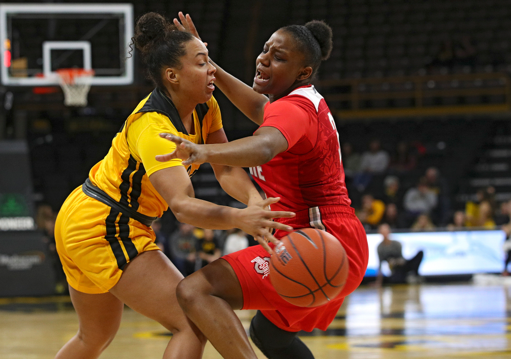 Iowa Hawkeyes guard Alexis Sevillian (5) passes the ball around Ohio State Buckeyes guard Janai Crooms (3) during the fourth quarter of their game at Carver-Hawkeye Arena in Iowa City on Thursday, January 23, 2020. (Stephen Mally/hawkeyesports.com)