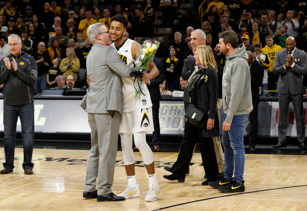 Iowa Hawkeyes forward Dom Uhl (25) and head coach Fran McCaffery