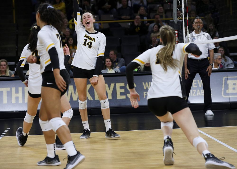 Iowa Hawkeyes outside hitter Cali Hoye (14) celebrates after winning a point during a match against Penn State at Carver-Hawkeye Arena on November 3, 2018. (Tork Mason/hawkeyesports.com)