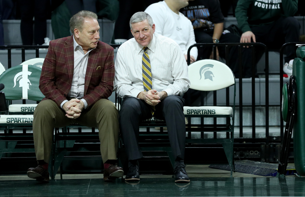Iowa Hawkeyes assistant coach Kirk Speraw  talks with Tom Izzo against Michigan State Tuesday, February 25, 2020 at the Breslin Center in East Lansing, MI. (Brian Ray/hawkeyesports.com)