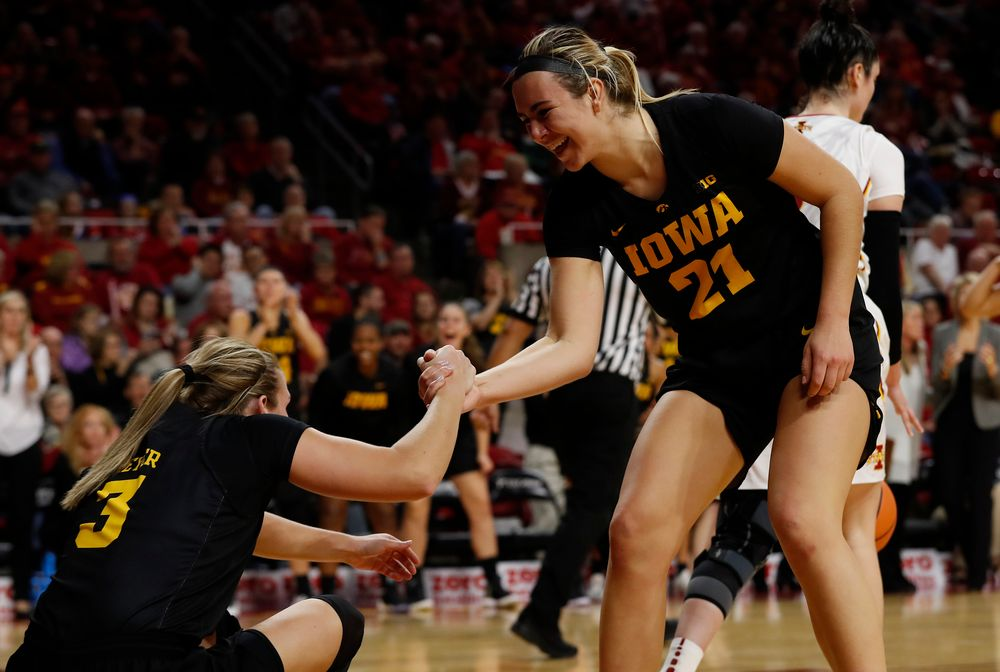Iowa Hawkeyes forward Hannah Stewart (21)  an d guard Makenzie Meyer (3)