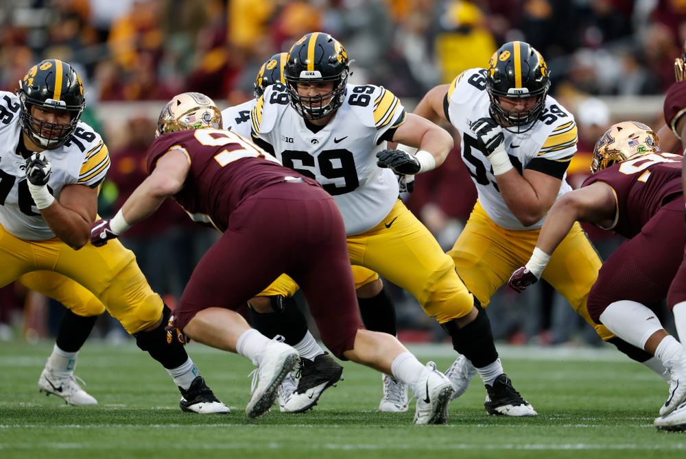 Iowa Hawkeyes offensive lineman Dalton Ferguson (76), offensive lineman Keegan Render (69), and Deffensive lineman Ross Reynolds (59) against the Minnesota Golden Gophers Saturday, October 6, 2018 at TCF Bank Stadium. (Brian Ray/hawkeyesports.com)