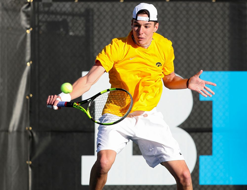 Iowa's Nikita Snezhko during their doubles match again Michigan State at the Hawkeye Tennis and Recreation Complex in Iowa City on Friday, Apr. 19, 2019. (Stephen Mally/hawkeyesports.com)