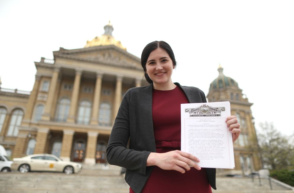 Iowa's Megan Gustafson holds up a copy of the resolution by the general assembly honoring her outside of the at the Iowa State Capitol Wednesday, April 24, 2019 in Des Moines. (Brian Ray/hawkeyesports.com)