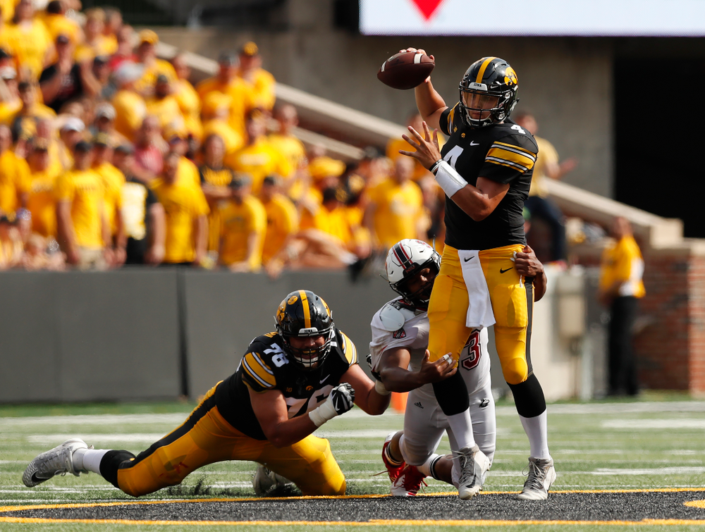 Iowa Hawkeyes quarterback Nate Stanley (4) completes a pass under pressure against the Northern Illinois Huskies Saturday, September 1, 2018 at Kinnick Stadium. (Brian Ray/hawkeyesports.com)
