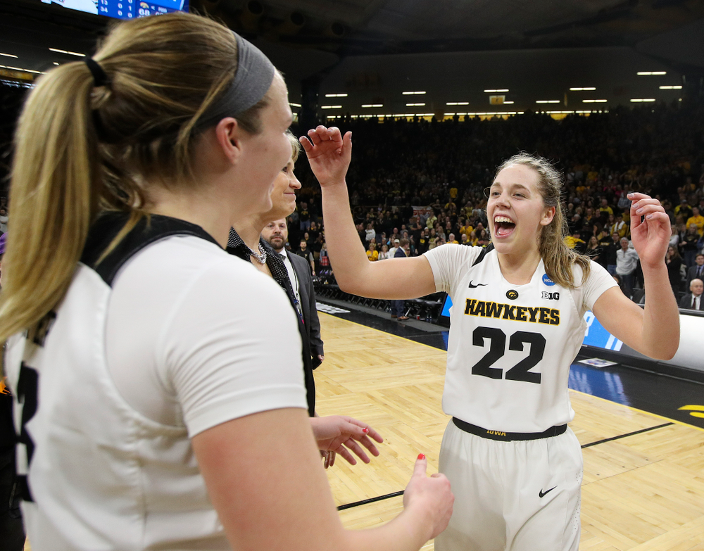 Iowa Hawkeyes guard Kathleen Doyle (22) and guard Makenzie Meyer (3) celebrate after winning their second round game in the 2019 NCAA Women's Basketball Tournament at Carver Hawkeye Arena in Iowa City on Sunday, Mar. 24, 2019. (Stephen Mally for hawkeyesports.com)