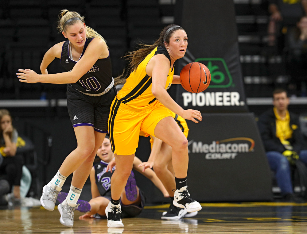 Iowa guard/forward McKenna Warnock (14) brings the ball down court during the second quarter of their game against Winona State at Carver-Hawkeye Arena in Iowa City on Sunday, Nov 3, 2019. (Stephen Mally/hawkeyesports.com)