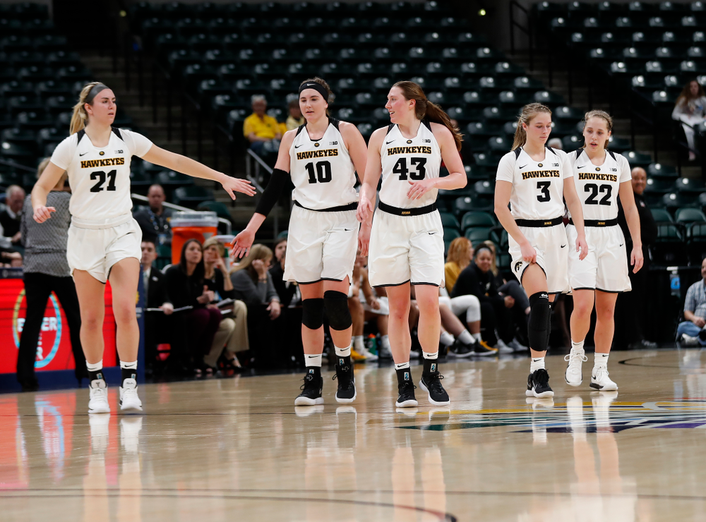 Iowa Hawkeyes forward Hannah Stewart (21), forward Megan Gustafson (10), forward Amanda Ollinger (43), guard Makenzie Meyer (3), and guard Kathleen Doyle (22)