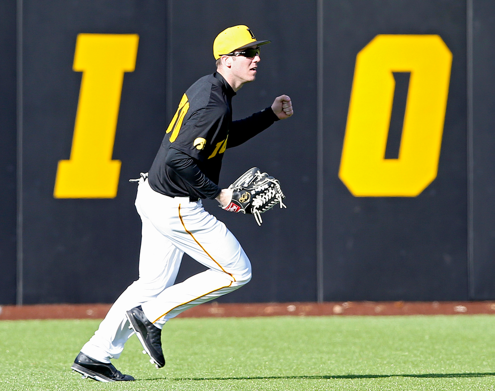 Iowa Hawkeyes left fielder Connor McCaffery (30) pumps his fist after catching a fly ball for the final out of the ninth inning of their game against Illinois at Duane Banks Field in Iowa City on Saturday, Mar. 30, 2019. (Stephen Mally/hawkeyesports.com)